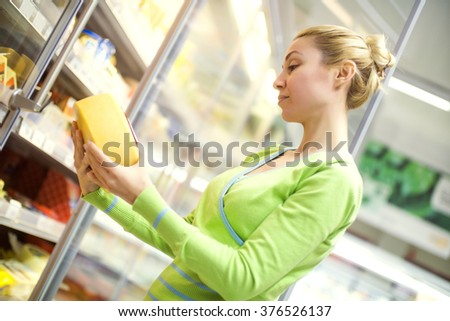 Woman doing shopping of merchandise in supermarket - stock photo