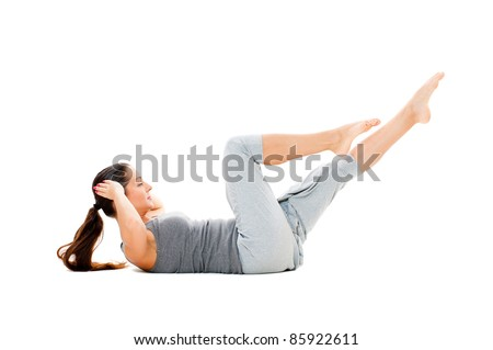 woman doing strength exercises for abdominal muscles. isolated on white background - stock photo