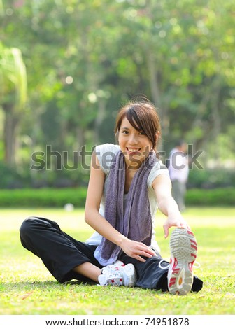 woman doing stretching exercise - stock photo