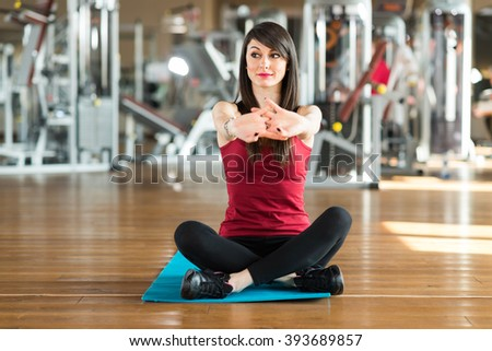 Woman doing stretching in a gym - stock photo