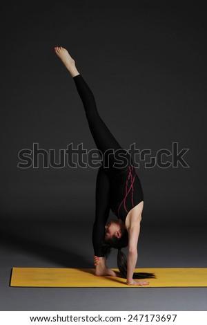 Woman doing yoga - stock photo