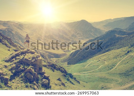 Woman doing yoga in the mountains - instagram style - stock photo