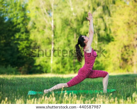 Woman doing yoga meditation in park - stock photo