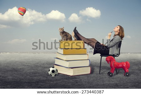 woman dreaming sitting on a chair in the open air. - stock photo