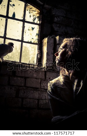 Woman dreams of freedom in a prison psychiatric - stock photo