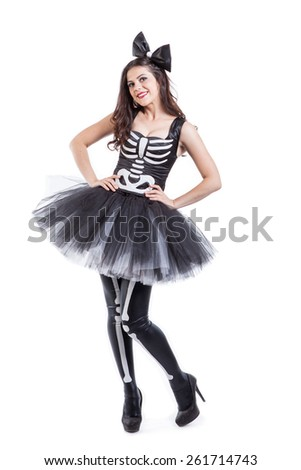 Woman dressed in carnival skeleton costume isolated on white background - stock photo