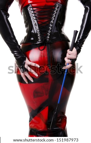 Woman dressed in dominatrix clothes, from back. - stock photo