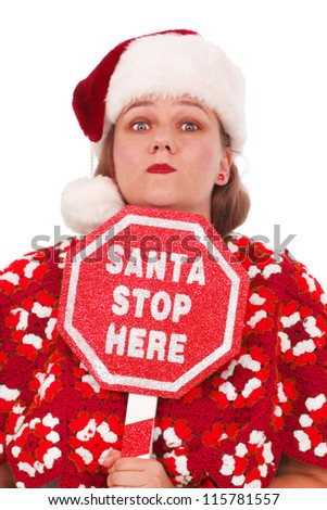 Woman dressed in red Christmas colors with a sign Santa Stop Here - stock photo