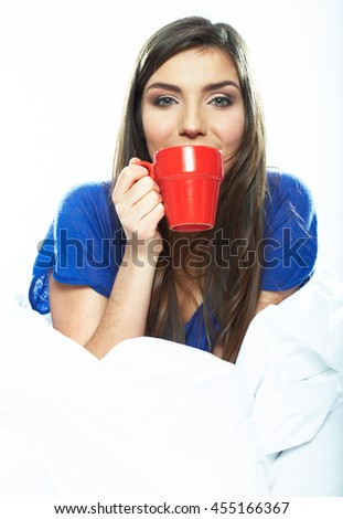 woman drink coffee in bed. Beautiful young model portrait. - stock photo