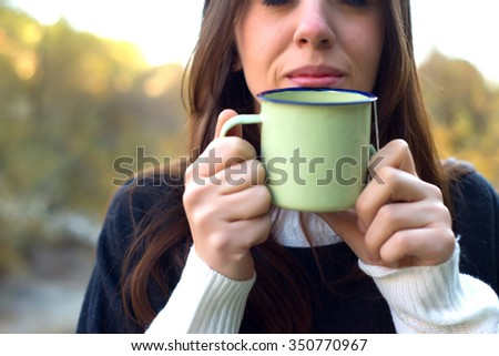Woman drinking a hot Drink in a cold Weather in Madrid - stock photo