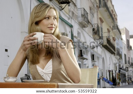 Woman drinking cappuccino - stock photo