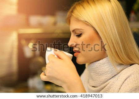 Woman drinking coffee in the morning. - stock photo