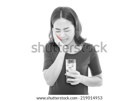 woman drinking cold drink, glass full of ice cubes and feels toothache, pain with red alert accent - stock photo
