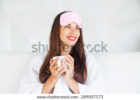 woman drinking hot beverage before going to bed to help her sleep - stock photo