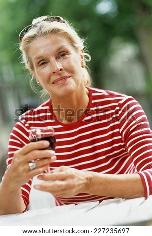 woman drinking red wine - stock photo