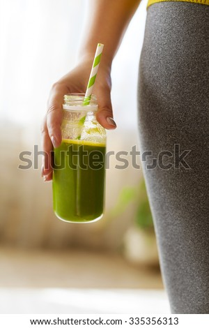 Woman drinking vegetable smoothie after fitness running workout. Fitness and healthy lifestyle concept - stock photo