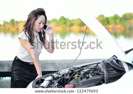 woman driver on the phone for car breakdown - stock photo