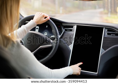 Woman driving new and modern car  - stock photo