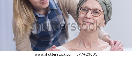 Woman during chemotherapy and girl holding hands on her shoulders, panorama. - stock photo
