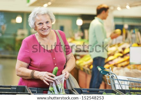 woman during shopping at fruit or vegetable supermarket store shop - stock photo