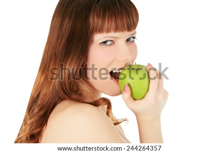 woman eating a green apple isolated over white background - stock photo