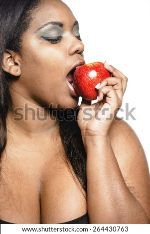 Woman eating apple - stock photo