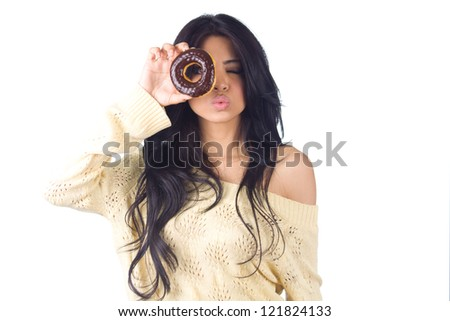 Woman eating donut on white background - stock photo