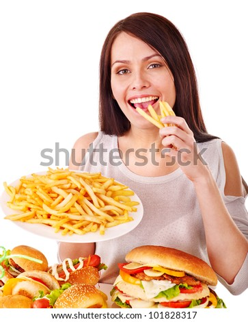 Woman eating fast food. Isolated. - stock photo