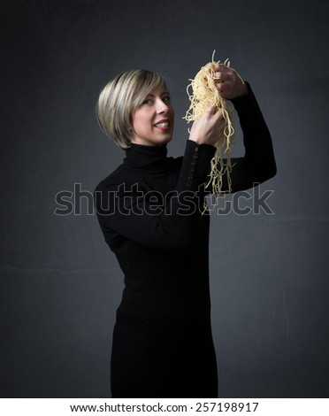 woman eating italian spaghetti with hands - stock photo