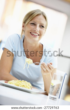 Woman Eating Lunch At A Cafe - stock photo