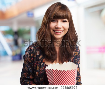 woman eating popcorn - stock photo
