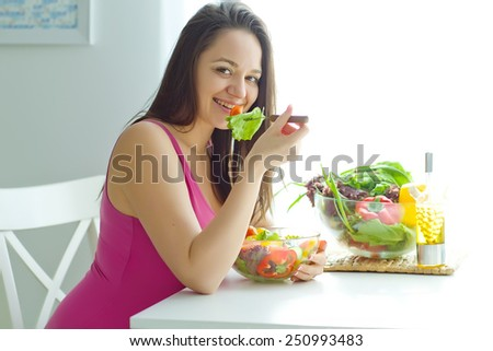Woman eating salad - stock photo