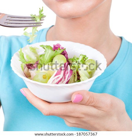 Woman eating salad, diet concept - stock photo