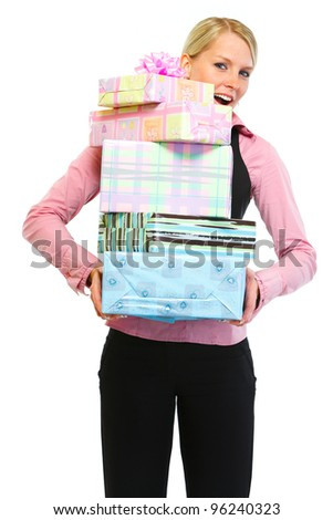 Woman employee with stack of present boxes - stock photo