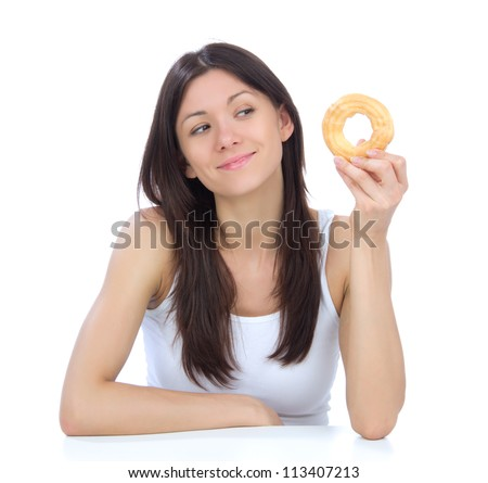 Woman enjoy sweet donut. Unhealthy junk food concept isolated on a white background - stock photo
