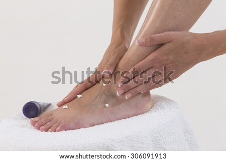 Woman enjoying a feet massage - stock photo
