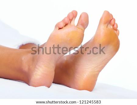 Woman enjoying a feet massage in a spa salon. - stock photo