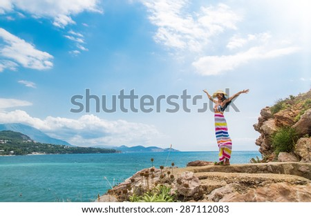 Woman enjoying at beach in summer freedom with open arms by the water seaside. Happy girl on travel leisure, outdoors.  Copay space - copyspace - stock photo