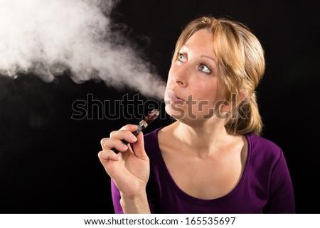 Woman enjoying e-cig - stock photo