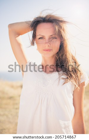 Woman enjoying freedom and life on beautiful and magical sunset. relaxed and happy - stock photo