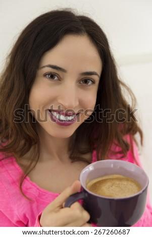 Woman enjoying her coffee - stock photo