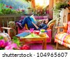 woman enjoying her comfortable terrace - stock photo