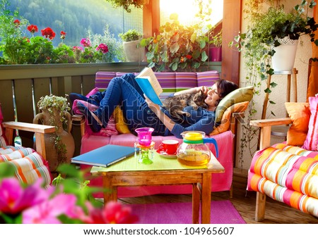 woman enjoying her comfortable terrace - stock photo