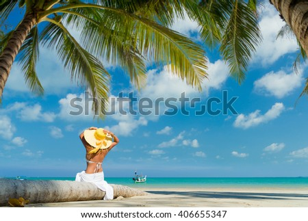 Woman enjoying her holidays on the tropical beach - stock photo
