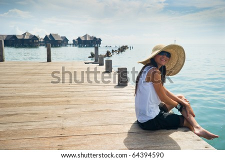 woman enjoying her vacation at the bay - stock photo