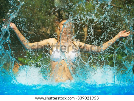 Woman enjoying her vacation in the swimming pool. - stock photo
