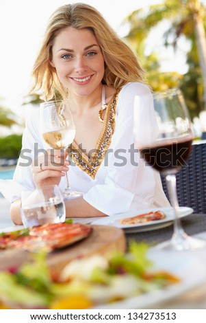 Woman Enjoying Meal In Outdoor Restaurant - stock photo