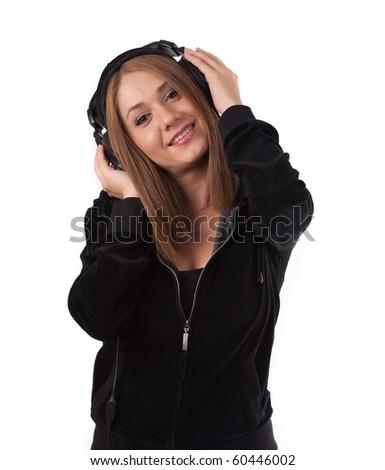 Woman enjoying music on headphones ,isolated on white - stock photo