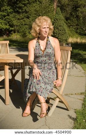 Woman enjoying relaxing in the sun in the garden of teh Awhanee lodge, Yosemite, California - stock photo