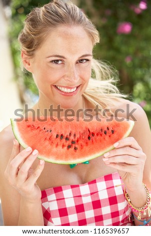 Woman Enjoying Slice Of Water Melon - stock photo